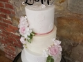 Lace and buttercream wedding cake with David Austin roses and foliage