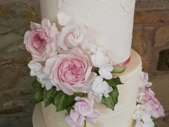 Lace and textured buttercream cake with sugar David Austin roses and green foliage