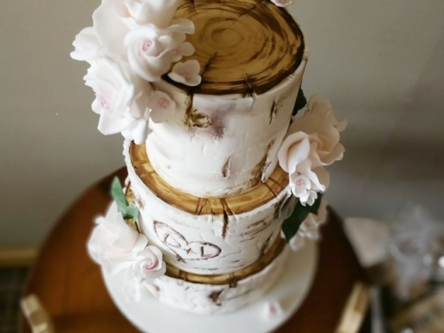 White Birch wedding cake with sugar roses and green foliage